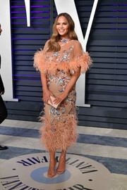 A simple box clutch (also by Jimmy Choo) rounded out Chrissy Teigen's ensemble.