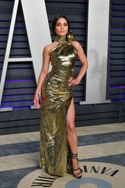 Vanessa Hudgens looked dazzling in a figure-hugging gold sequined gown by Dundas at the 2019 Vanity Fair Oscar party.