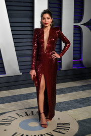Freida Pinto rocked a ruby-red sequined gown with a plunging neckline and a high front slit at the 2019 Vanity Fair Oscar party.