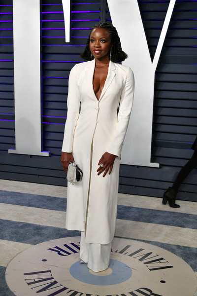 Danai Gurira styled her look with a pearl fringe clutch by Roger Vivier.