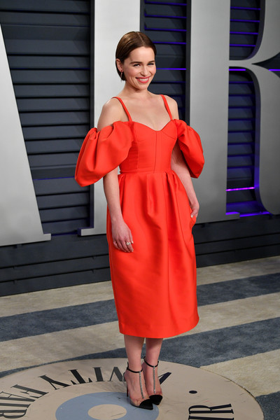 Emilia Clarke styled her dress with bedazzled T-strap pumps by Christian Louboutin.