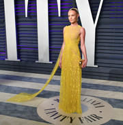 Kate Bosworth was a glamorous burst of sunshine in a beaded yellow column dress by Cong Tri at the 2019 Vanity Fair Oscar party.