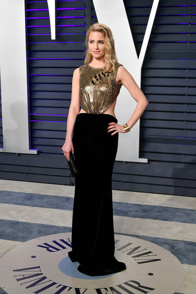 Dianna Agron showed off her svelte figure in a gold and black cutout gown by Armani Privé at the 2019 Vanity Fair Oscar party.