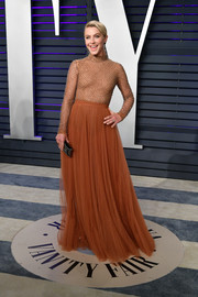 Julianne Hough attended the 2019 Vanity Fair Oscar party wearing a rust-colored gown with a studded bodice and a floaty tulle skirt.