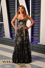 Sofia Vergara went for flirty glamour in a low-cut floral-beaded gown by Dolce & Gabbana at the 2019 Vanity Fair Oscar party.