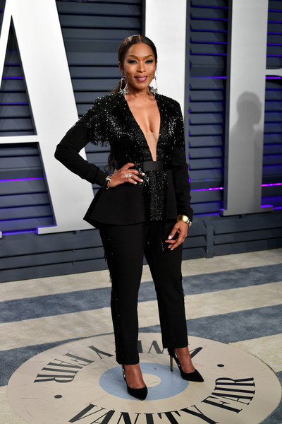 Angela Bassett went for easy glamour in a fringed black jumpsuit by Vitor Zerbinato at the 2019 Vanity Fair Oscar party.
