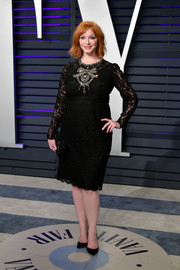 Christina Hendricks went for classic elegance in a crystal-embellished lace dress by Dolce & Gabbana at the 2019 Vanity Fair Oscar party.