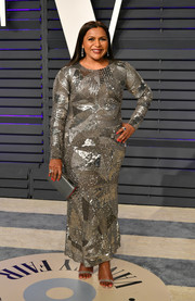 Mindy Kaling matched her shimmering dress with a silver box clutch.