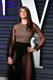 Shailene Woodley accessorized with an embroidered satin clutch by Christian Dior at the 2019 Vanity Fair Oscar party.