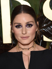 Olivia Palermo prettied up her eyes with a swipe of purple shadow.