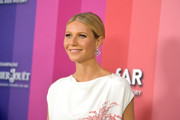 Gwyneth Paltrow styled her hair into a simple center-parted updo for the 2019 amfAR Gala Los Angeles.