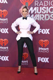 Halsey went androgynous in a white Dsquared2 tuxedo shirt with a peplum waist at the 2019 iHeartRadio Music Awards.