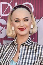 Katy Perry swiped on some red lipstick for a pop of color to her black-and-white look.