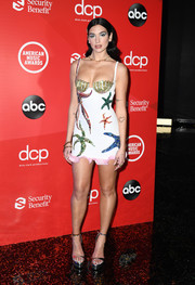 Dua Lipa showed off her physique in a figure-hugging starfish-beaded bustier dress by Versace at the 2020 American Music Awards.