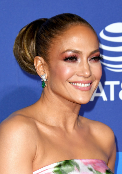 Jennifer Lopez styled her hair into a massive bun for the 2020 Palm Springs International Film Festival Awards.