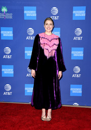 Greta Gerwig hit the 2020 Palm Springs International Film Festival Awards wearing a purple Gucci velvet dress with pink fringe bib detailing.