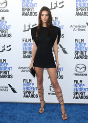 Emily Ratajkowski amped up the sultry vibe with a pair of black lace-up heels, also by Versace.