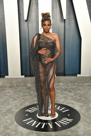 Ciara dared to bare in a see-through Ralph & Russo Couture dress at the 2020 Vanity Fair Oscar party.