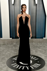 Sara Sampaio ravished in a plunging, strapless black gown by Armani Privé at the 2020 Vanity Fair Oscar party.