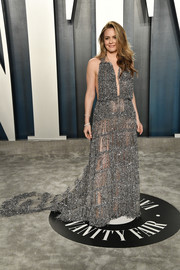 Alicia Silverstone showed her daring side in a sheer, beaded silver gown by Christian Siriano at the 2020 Vanity Fair Oscar party.