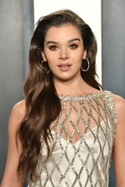 Hailee Steinfeld complemented her heavily embellished dress with a pair of diamond hoops by Anita Ko.