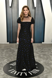 Amanda Peet looked demure in an embroidered black gown with a sheer yoke and sleeves at the 2020 Vanity Fair Oscar party.