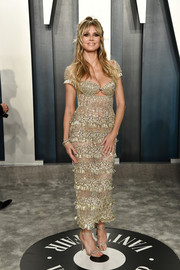 Heidi Klum looked absolutely dazzling in a beaded gold dress by Georges Hobeika Couture at the 2020 Vanity Fair Oscar party.