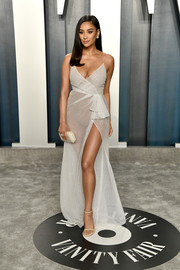Shay Mitchell looked alluring in a sheer white wrap gown by Honayda at the 2020 Vanity Fair Oscar party.