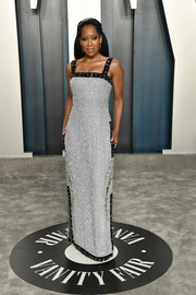 Regina King turned heads in a fully beaded gray column dress by Prada at the 2020 Vanity Fair Oscar party.