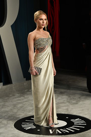 Scarlett Johansson coordinated her dress with strappy silver heels by Jimmy Choo.