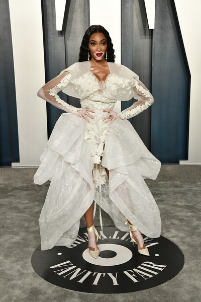 Winnie Harlow looked ultra modern in a sculptural white dress by Andreas Kronthaler for Vivienne Westwood at the 2020 Vanity Fair Oscar party.