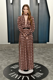 Riley Keough opted for printed maxi dress by Louis Vuitton when she attended the 2020 Vanity Fair Oscar party.