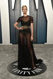 Karolina Kurkova turned heads in a sheer black gown by Etro at the 2020 Vanity Fair Oscar party.