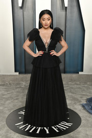 Lana Condor channeled her inner princess in a black peplum gown with bowed sleeves at the 2020 Vanity Fair Oscar party.