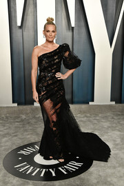Molly Sims worked a sheer, asymmetrical black gown by Georges Chakra at the 2020 Vanity Fair Oscar party.