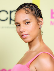 Alicia Keys styled her hair into a cornrow updo for the 2021 Billboard Music Awards.