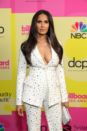 Padma Lakshmi teamed a beaded silver clutch by Tyler Ellis with a cream pantsuit for the 2021 Billboard Music Awards.