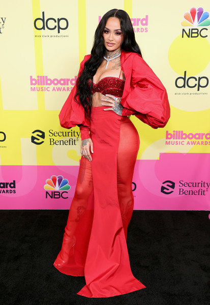 A long red skirt with sheer sides sealed off Kehlani's look.