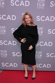 Lea Thompson matched her sweater with a black pencil skirt.