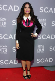 Salma Hayek was retro-chic in a black Gucci dress with a contrast collar and cuffs and bib detailing at the SCAD Savannah Film Festival screening of 'Mudbound.'