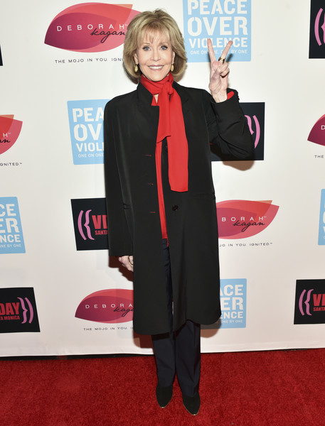 Jane Fonda donned a black duster and jazzed it up with a red scarf for the 20th anniversary of V-Day.
