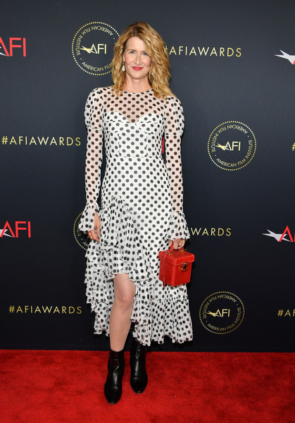 Laura Dern contrasted her sweet frock with edgy black ankle boots.