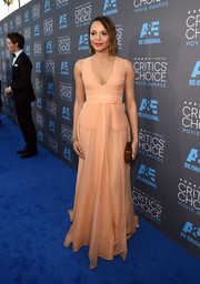 Carmen Ejogo arrived at the Critics' Choice Movie Awards wearing a stunning nude gown with pocket details.