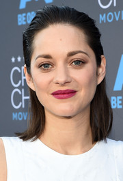 Marion Cotillard punched up her beauty look with a sweet raspberry lip.