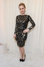 Anna Paquin turned on the glamor in a black and gold cocktail dress.