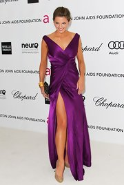 Stana Katic wore this ravishing plum gown with a thigh-high slit to the Elton John Oscar viewing party.