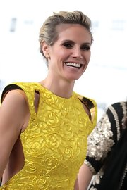 Heidi Klum wore her hair in a simple bobby-pinned updo while attending the Elton John Oscar viewing party.