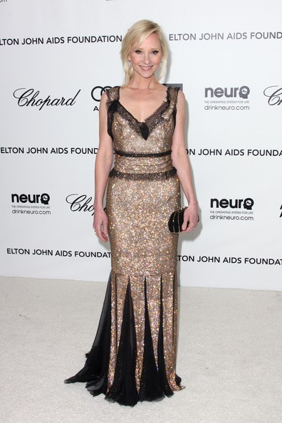 Anne Heche wore this glittering gold gown with knee-length pleats to Elton John's Oscar viewing party.