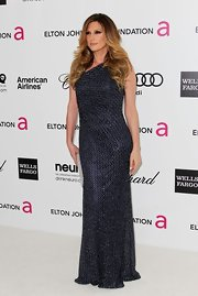 Daisy Fuentes wore this one-shoulder glittering gown to the Elton John Oscar viewing party.