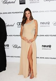 Alessandra accessorized her one-shoulder gown with metallic strappy sandals.